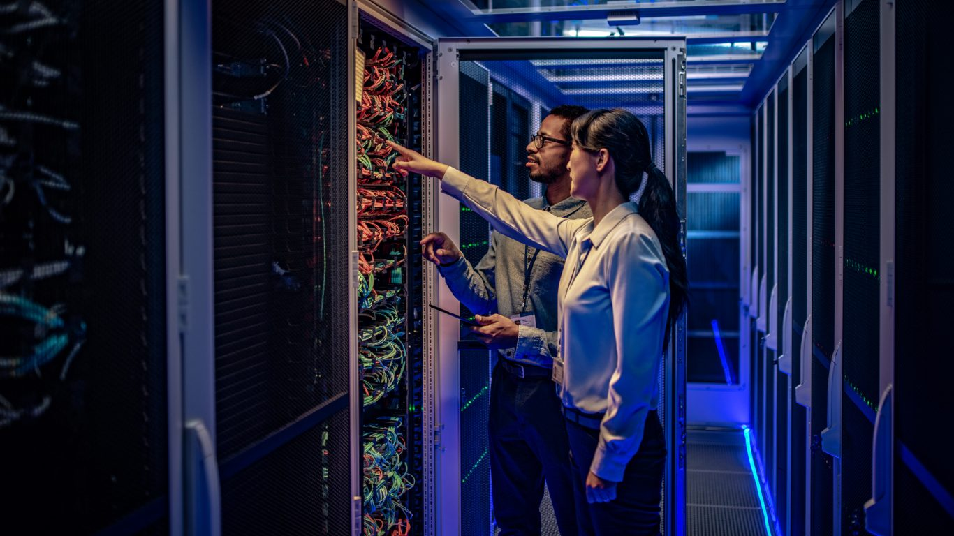 People working next to datacentre rack